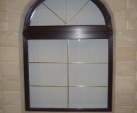Вариант обрамления арочного окна